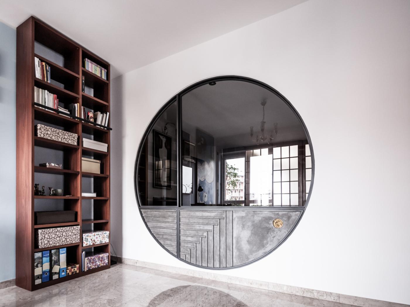 Trasformare una vetrata interna in un piccolo gioiello di interior design. Il lato studio modello il calcestruzzo e la foglia d'oro | Bottega di Architettura
